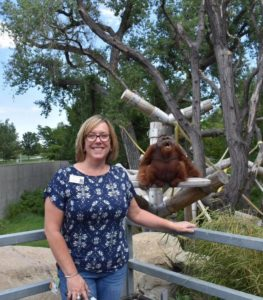 photo of stephanie stowell and an orangutan at denver zoo